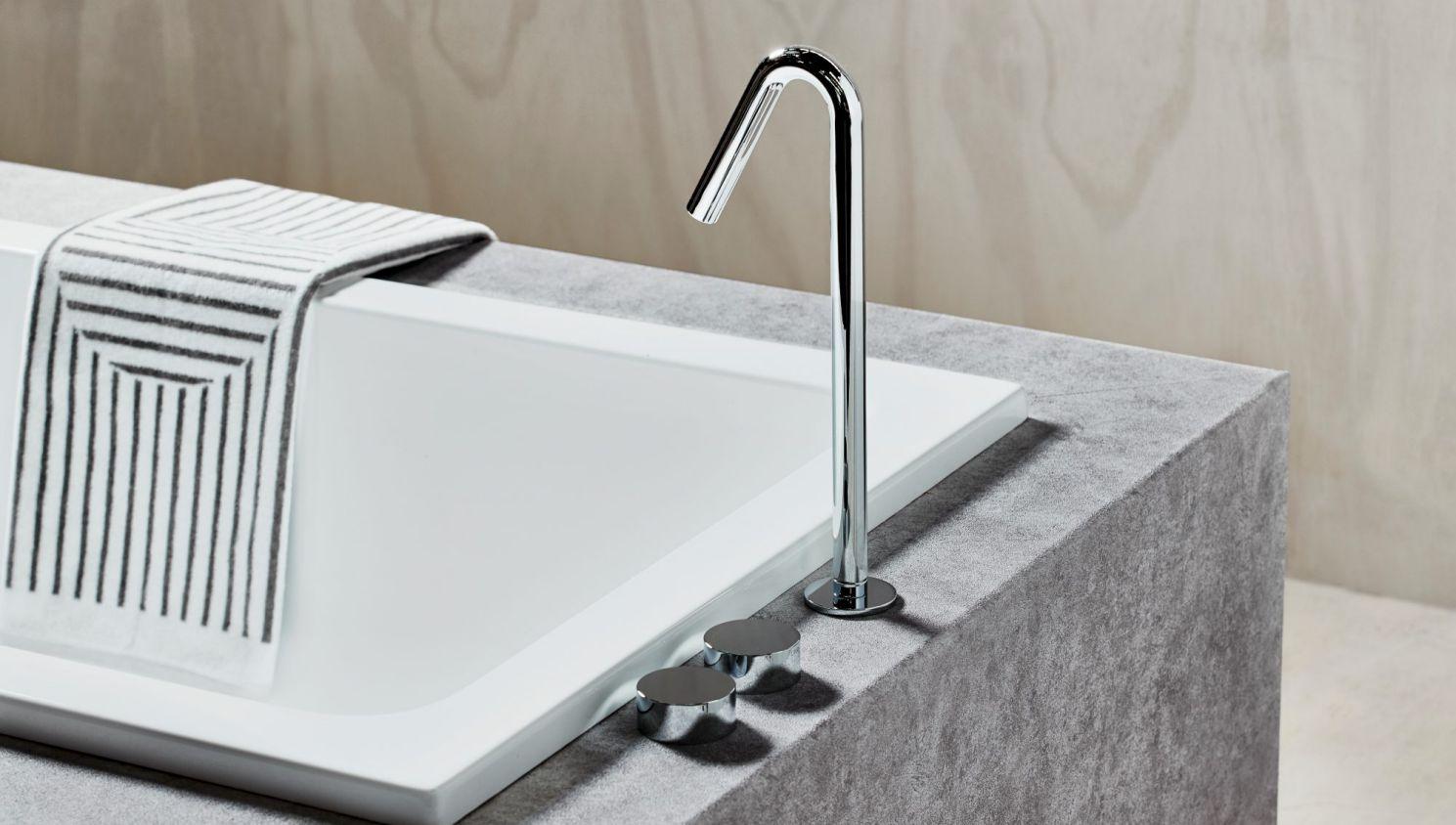 A simple yet elegant sink standing over a modern bath // reece.com.au