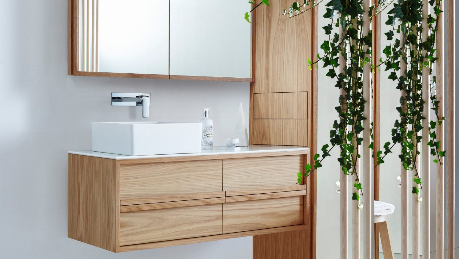 Light wooden vanity with plain white sheets // reece.com.au